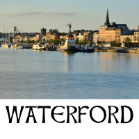 A picture of Waterford city with text underneath denoting the name of the city