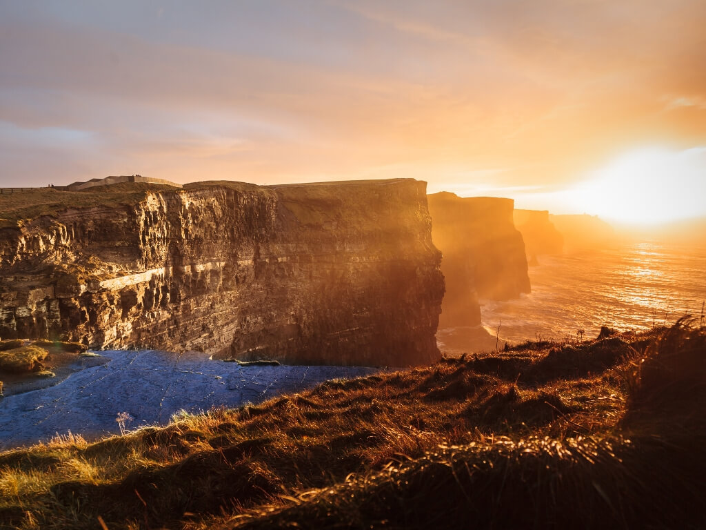 A sunset picture of the Cliffs of Moher in Ireland