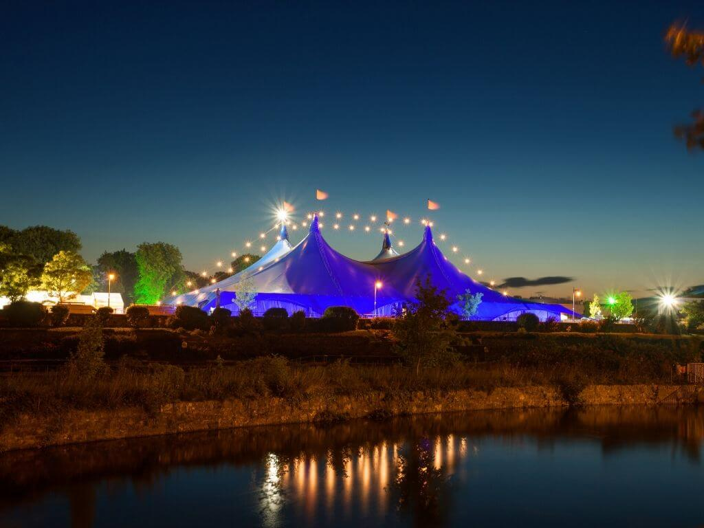 The main tent at the Galway Arts Festival with lights along the big top
