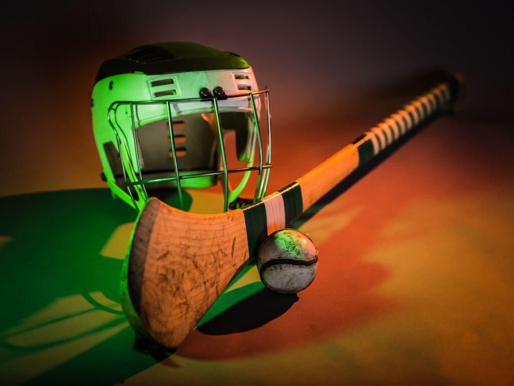 A picture of an Irish hurl (stick), the sliotar (ball) and helmet from an Irish hurley player