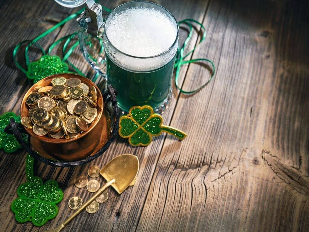 A picture of gold coins in a pot, shamrocks and a pretend pint of green guinness for St Patricks Day