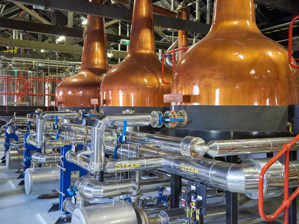A picture of three stills in the Jameson Distillery in Midleton, Cork, Ireland