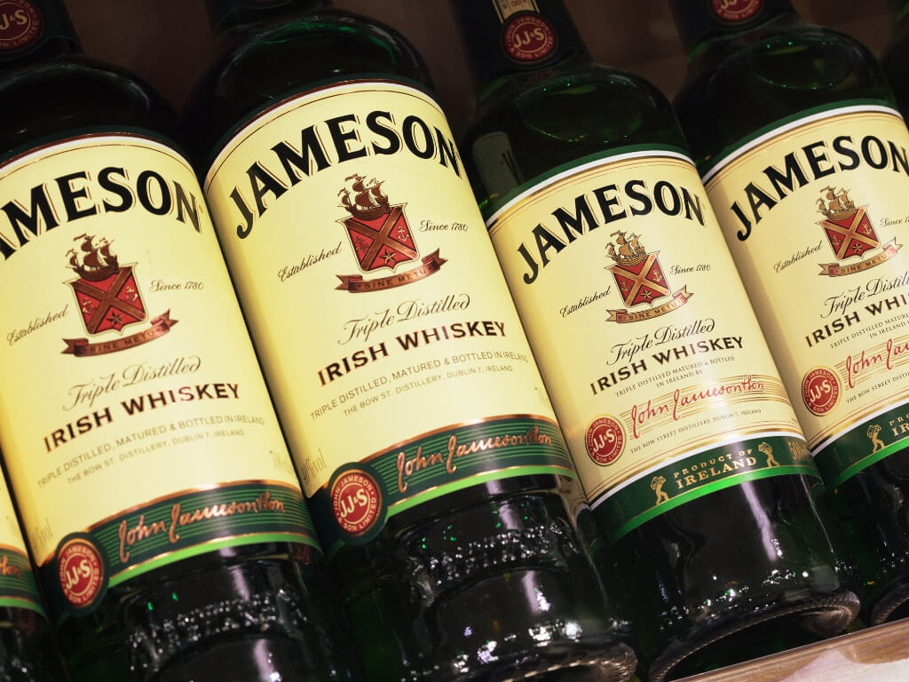A picture of a line of Jameson Irish Whiskey bottles