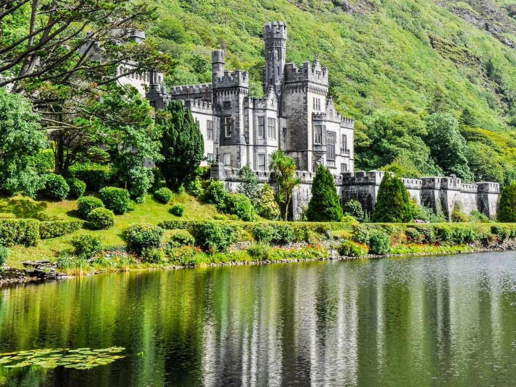 A picture of Kylemore Abbey, nestled on the lush green banks of Lake Kylemore.