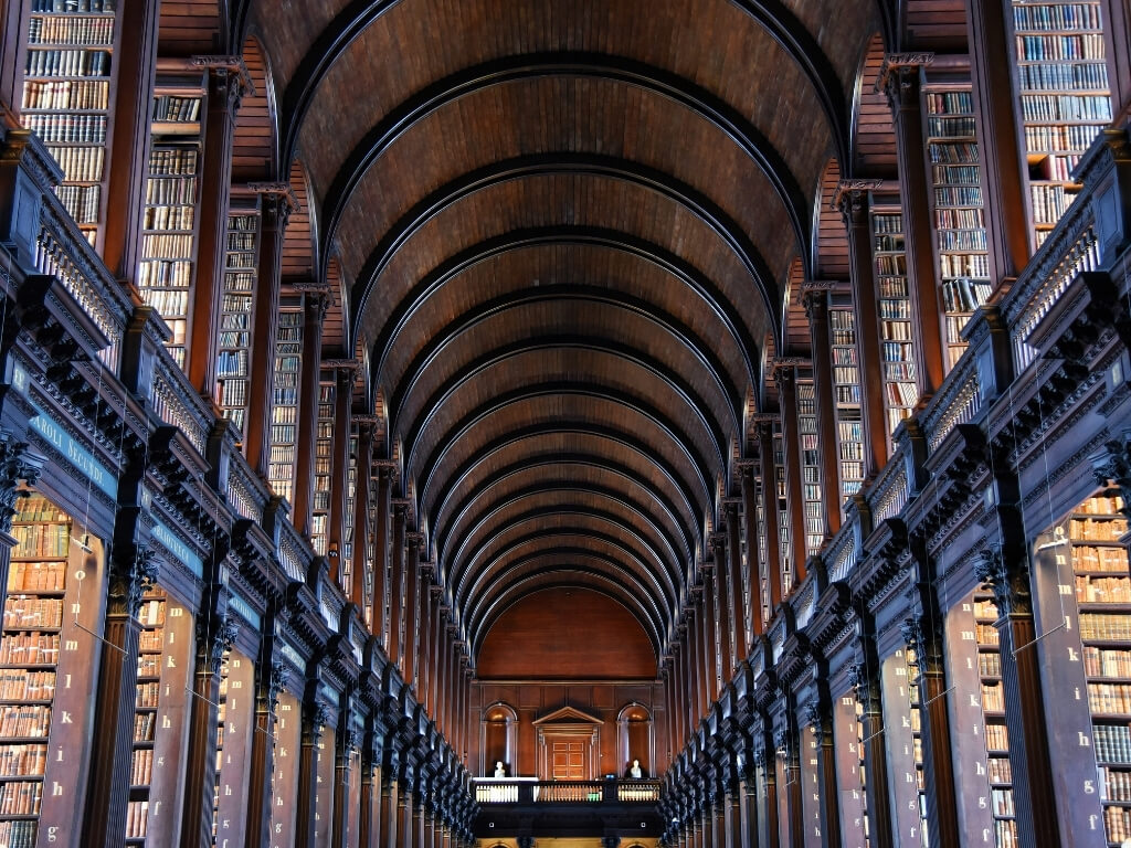 A picture of the tall shelves in the Long Room in the Old Library in Trinity College, Dublin, where you will find one of the best things to see in Dublin, the Book of Kells