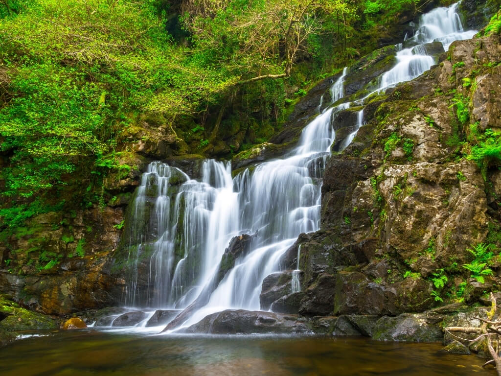 A picture of the stunning Torc Waterfall in Killarney National Park, one of the best places to visit in Ireland