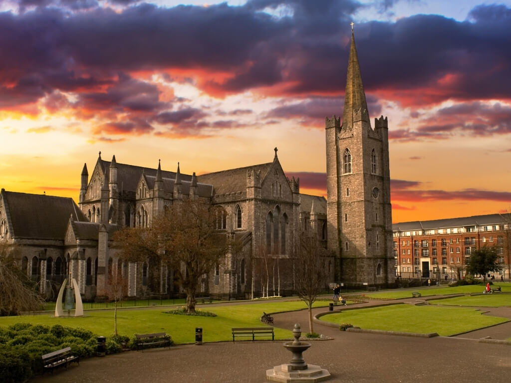 A picture of St Patrick's Cathedral in Dublin, Ireland with a moody sky above it
