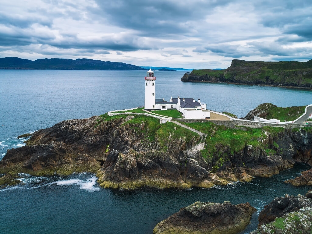 A picture of the Fanad Lighthouse on the Fanad Peninsula along the Wild Atlantic Way, one of the best lighthouses in Ireland to visit
