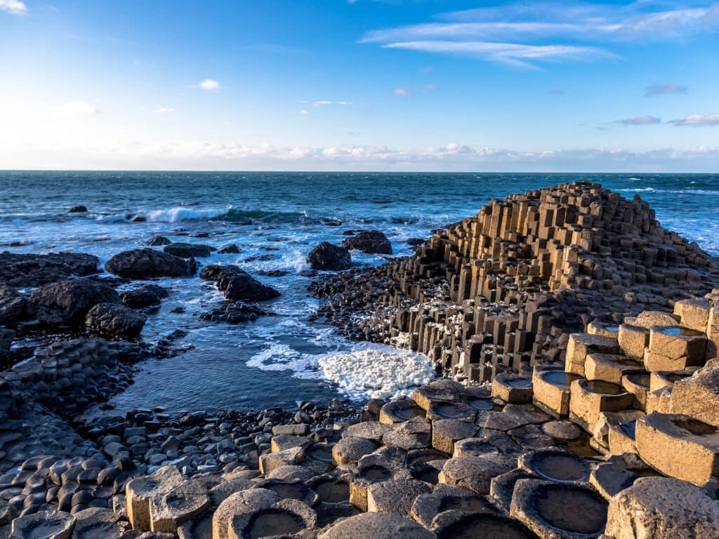 A picture of the Giant's Causeway with blue skies above it
