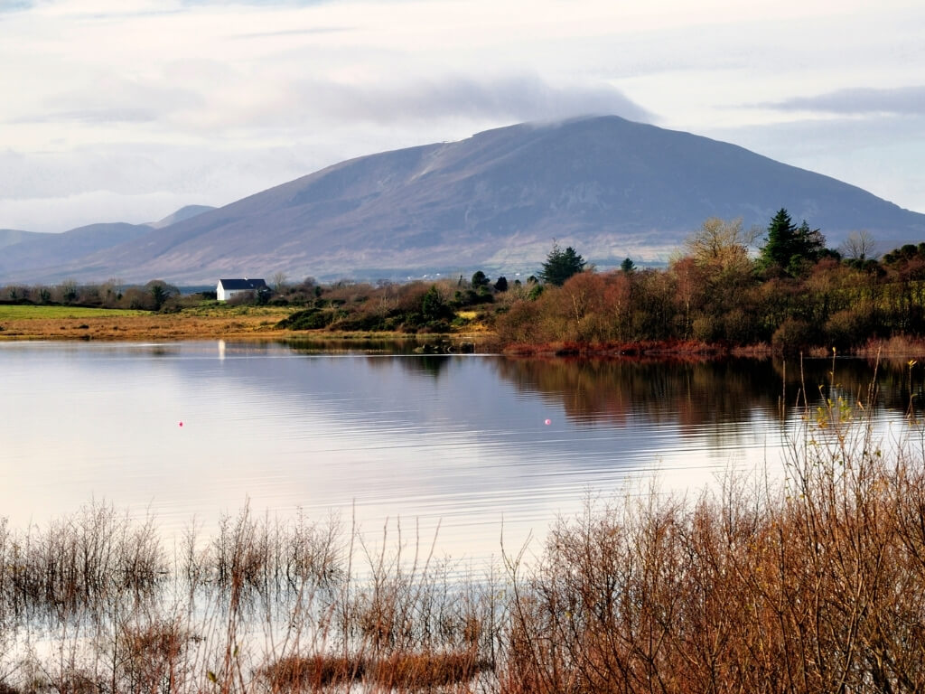 A picture of a lake in the foreground with a view of the Nephin mountain in the background in the Ballycroy National Park in Ireland