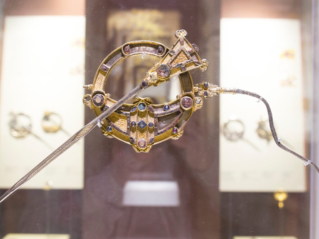A picture of an Irish broach and pin in the National Museum of Ireland Archaeology branch, one of the best free museums in Dublin