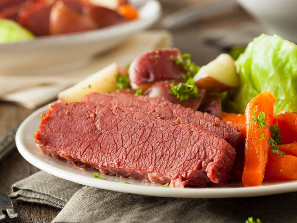 A picture of a plate containing Irish corned beef with vegetables