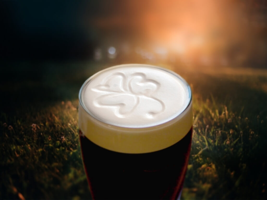 A picture of the head of a pint of Guinness topped with a shamrock