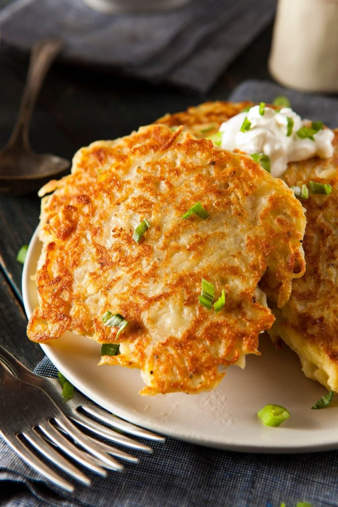 A picture of a plate of Irish boxty pancakes garnished with chives