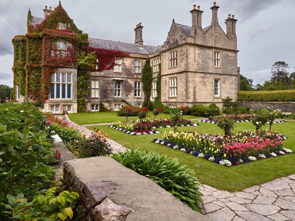 A picture of Muckross House and the landscaped gardens in front of the house