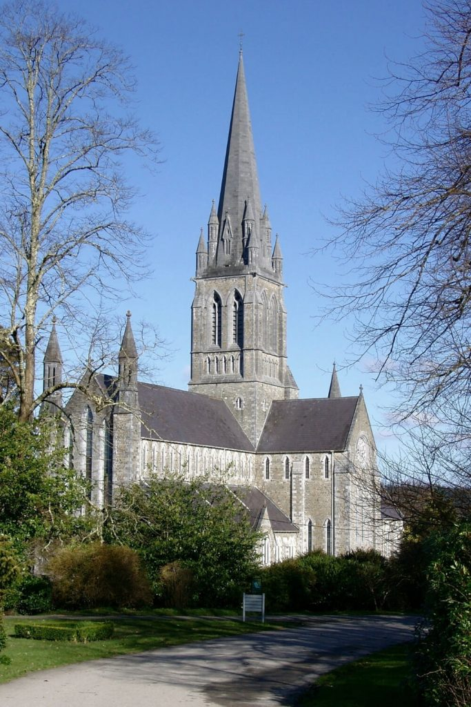 A picture of St Mary's Cathedral in Killarney, Ireland in the sunlight with blue skies overhead