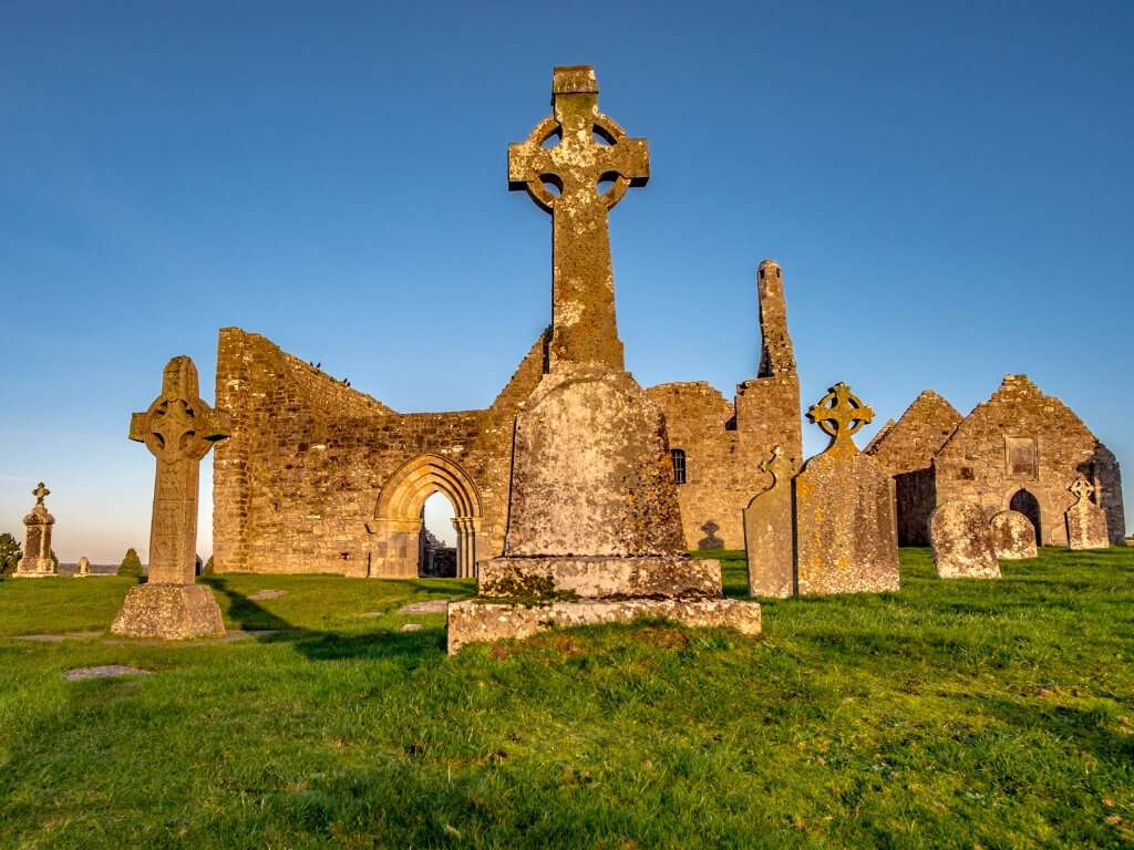A picture of some of the high crosses and ruined monastic buildings at Clonmacnoise, Ireland
