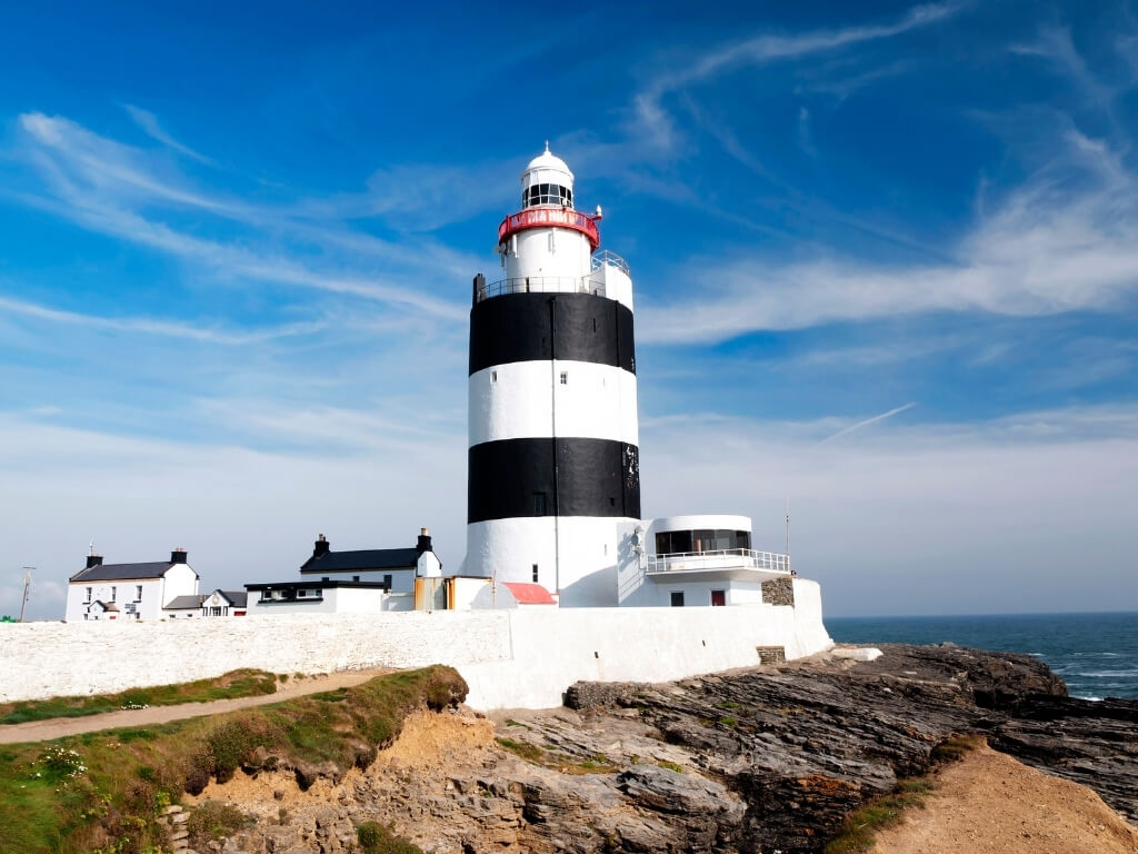 A picture of the lighthouse at Hook Head, Wexford with blue skies above