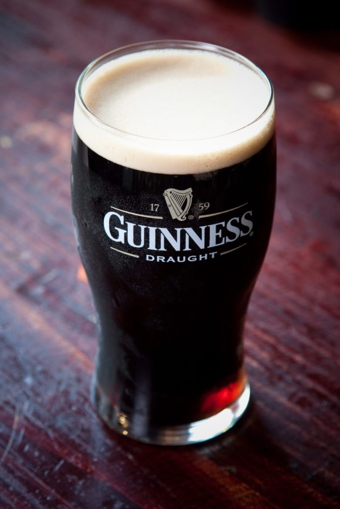 A picture of a poured and settled pint of Guinness