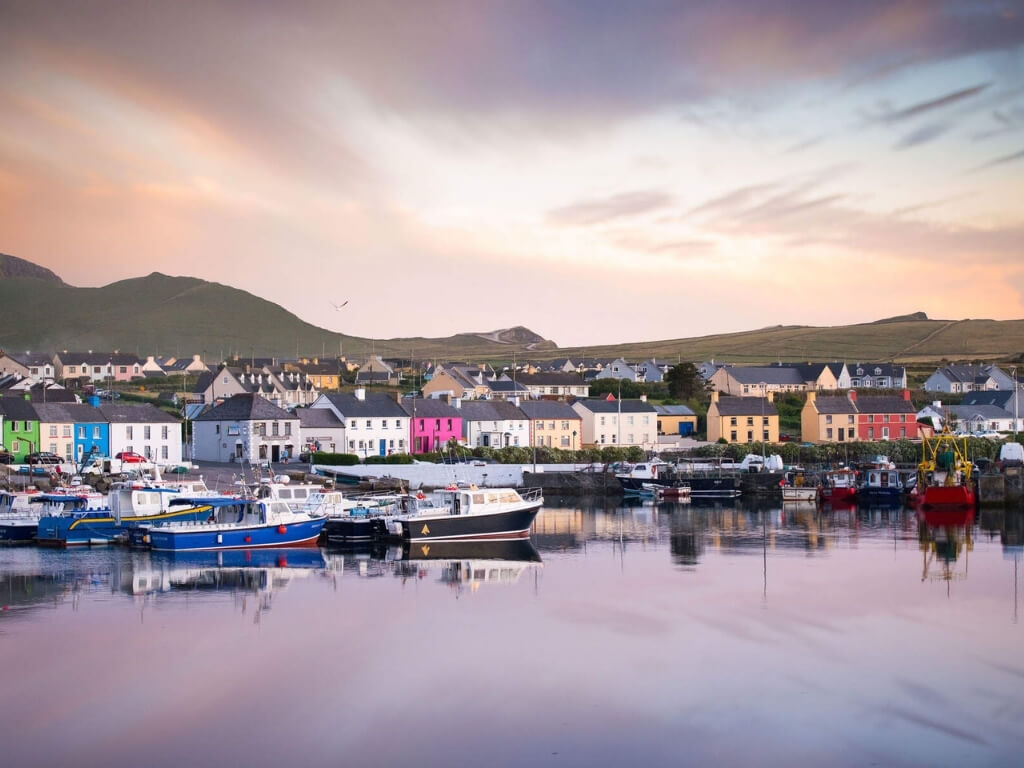 A picture of the harbour side at Portmagee, Kerry with colourful houses dotted in between white ones