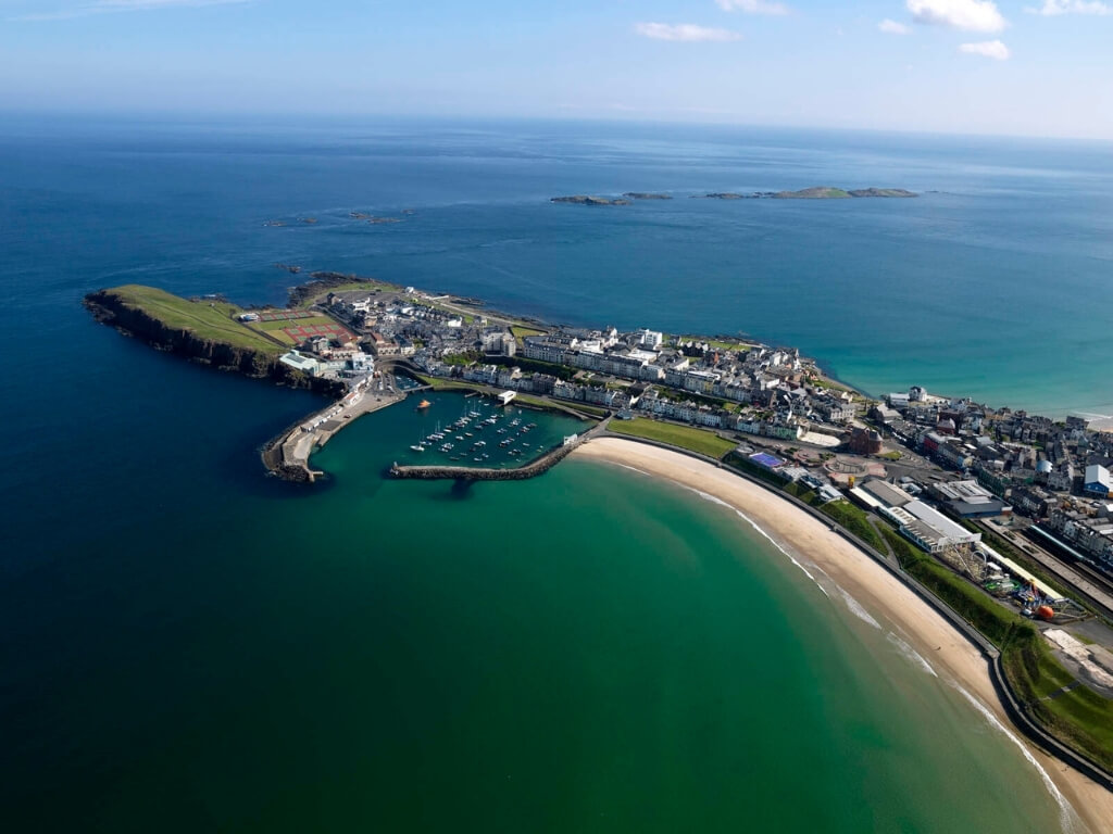A picture of the sandy beach and marina of Portrush in County Armagh