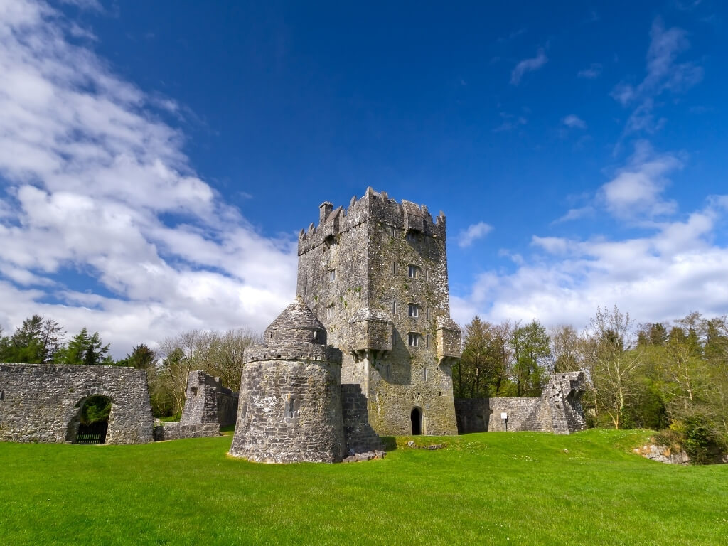 A picture of Aughnanue Castle with blue skies above, one of the best things to do in Galway, Ireland