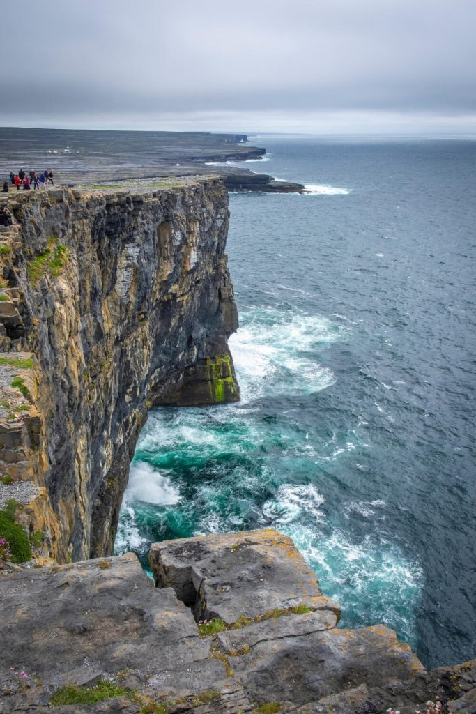 A picture of the sheer cliffs at Dun Aonghasa on Inishmor, the biggest of the Aran Islands