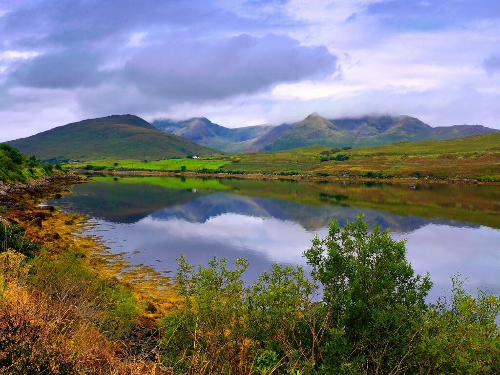A picture of the still waters of Killary Harbour with mountains in the background