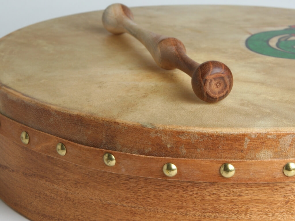 A picture of an Irish bodhran with a wood tipper
