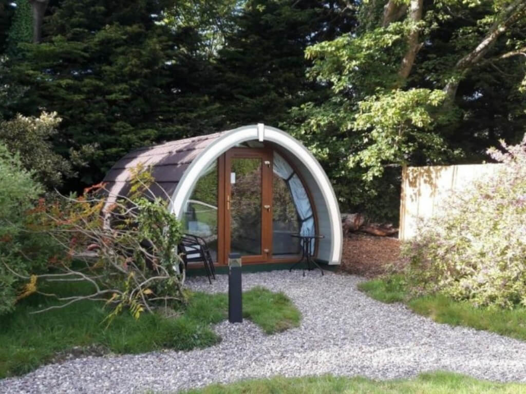 A picture of a glamping pod set among the trees at the Priory Glamping Pods and Guest Accommodation, Kerry