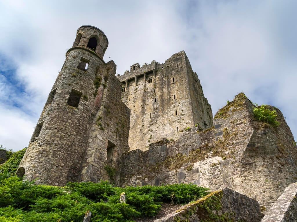 A picture of the circular tower and tower house of Blarney Castle, one of the best castles to visit in Ireland