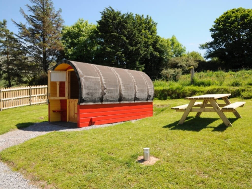 A picture of the red and black pod at Coach Field Glamping, Camp, Kerry