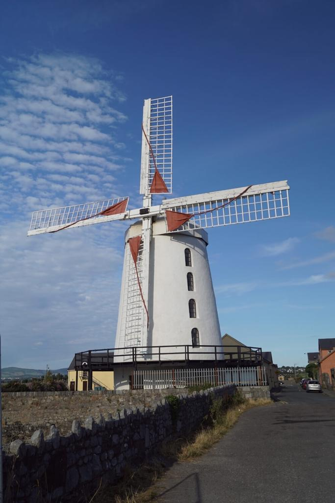 A picture of the white Blennerville Windmill in County Kerry with blue skies overhead