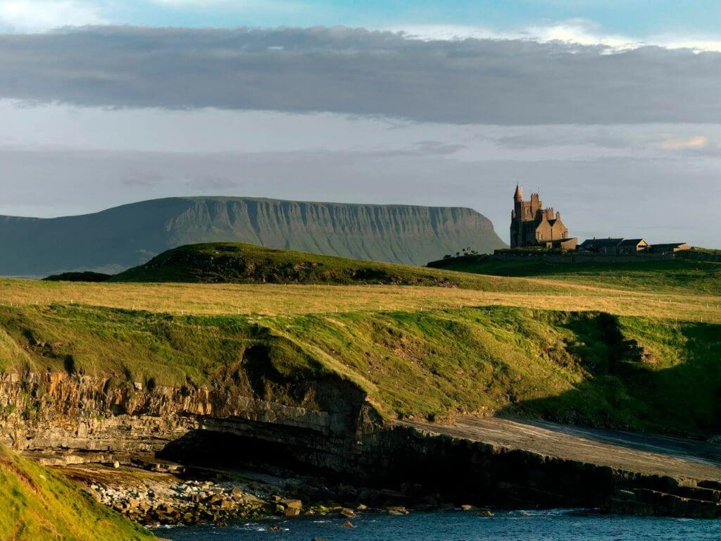 A picture of Sligo landscape with the Classiebawn Castle in the distance and Benbulbin behind it