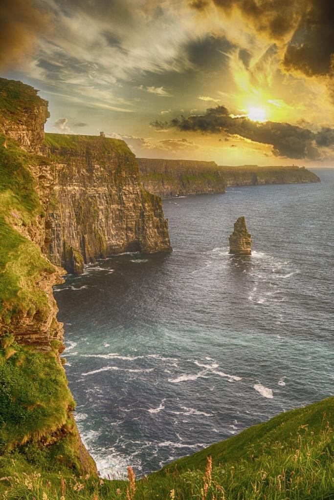 A picture of the sun setting over the Cliffs of Moher that lie along the Wild Atlantic Way, Ireland
