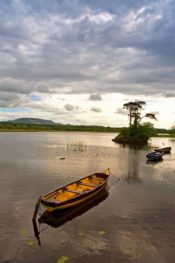 A picture of some small boats on Lough Gill in County Sligo, Ireland