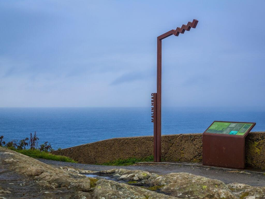 A picture of the Malin Head Signature Discovery Point in County Donegal, the start or endpoint of the Wild Atlantic Way in Ireland