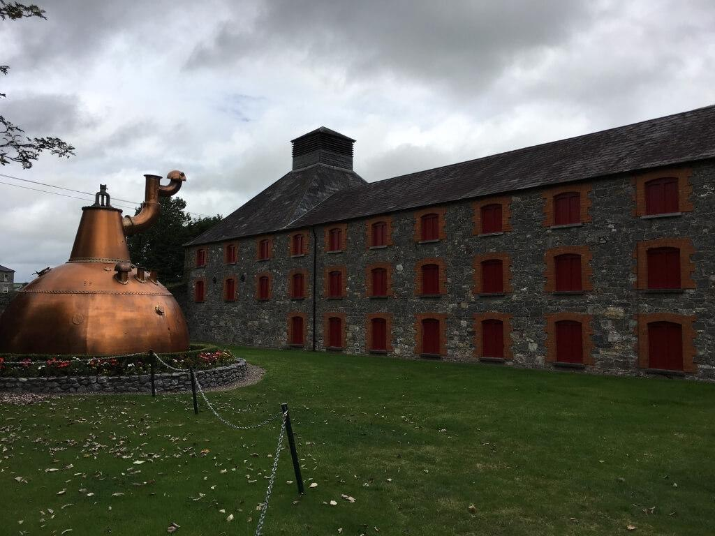 A picture of a copper stil outside the Jameson Experience at the Midleton Distillery