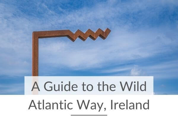 A picture of the logo for Ireland's longest coastal driving route with text overlay saying A Guide to the Wild Atlantic Way, Ireland