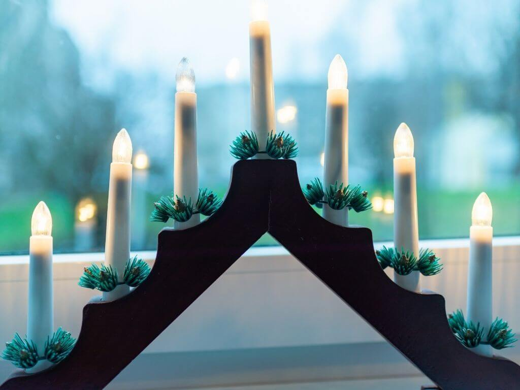 A picture of a traditional Christmas Candle in the Window with 7 electronic candles