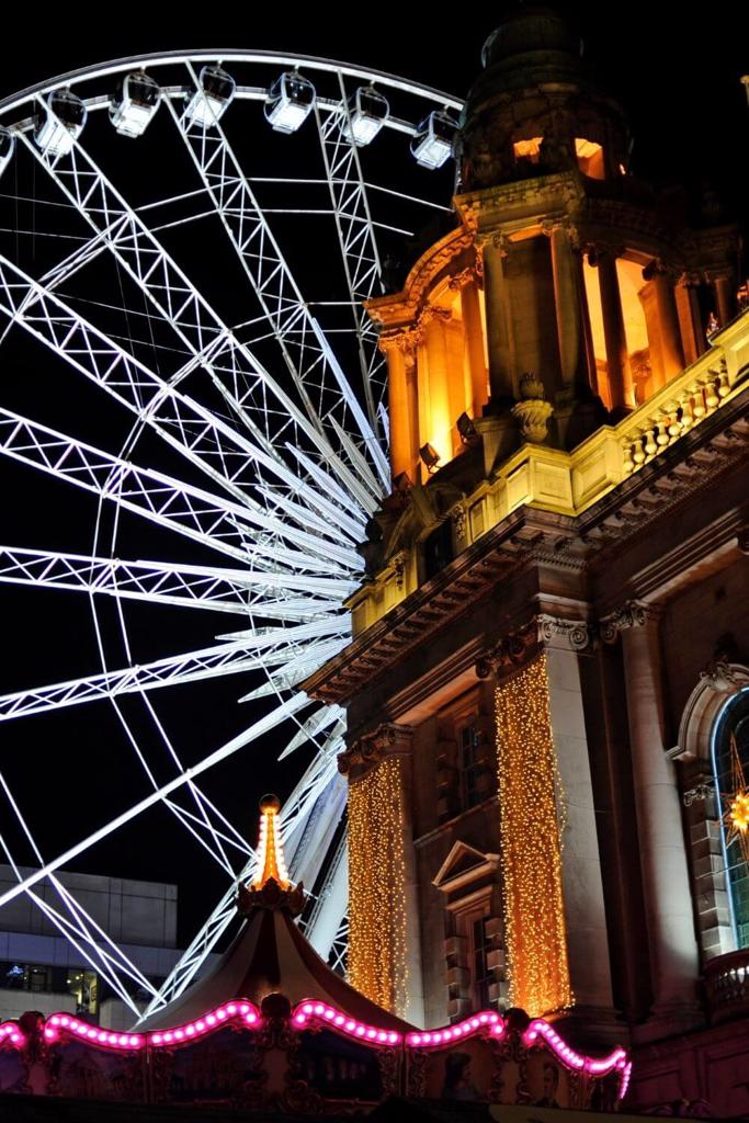 A picture of Belfast City Hall and Christmas Ferris Wheel