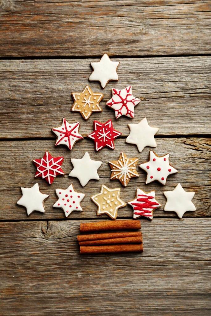 A picture of some star Christmas biscuits arranged in the shape of a Christmas tree