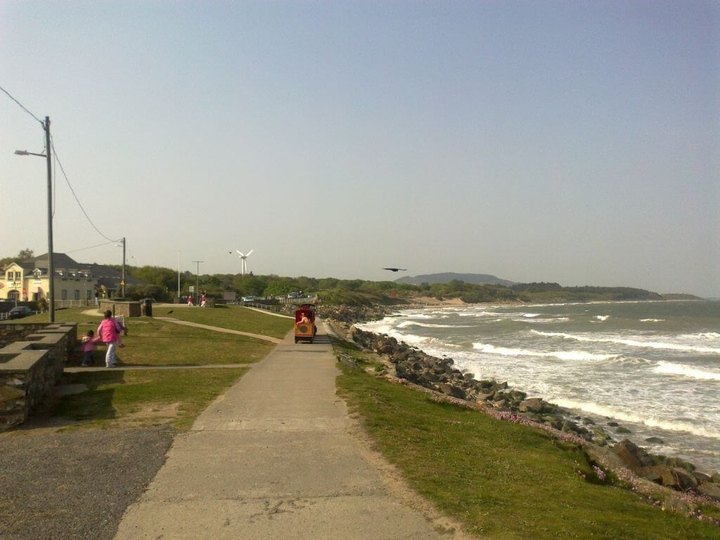 A picture of the promenade and small train approaching along it at Courtown, Wexford