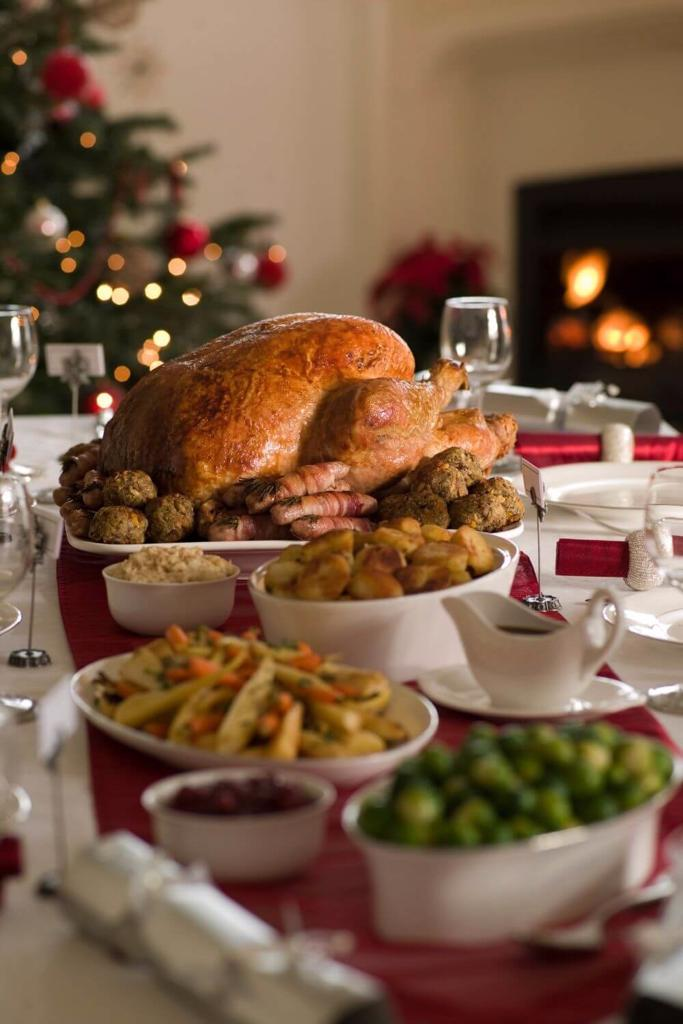 A picture of a Traditional Irish Christmas Dinner with roast turkey, roast potatoes and more