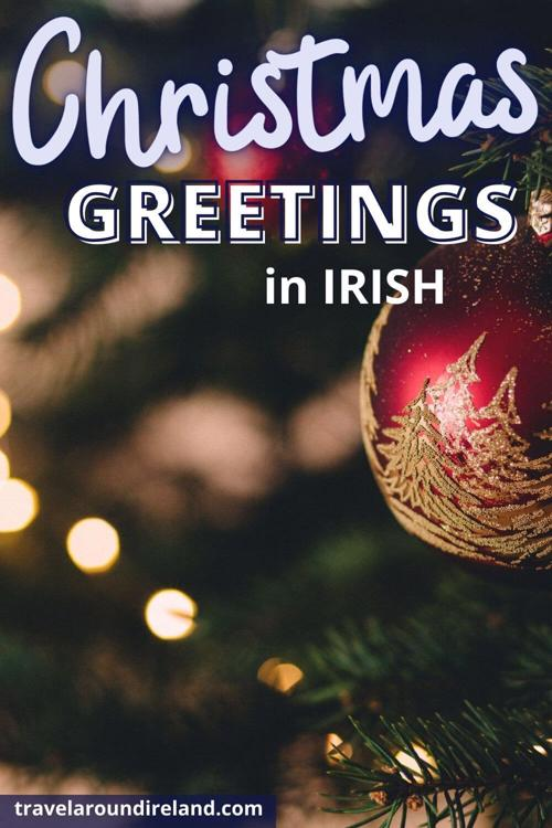 A Christmas bauble with text overlay saying Christmas Greetings in Irish