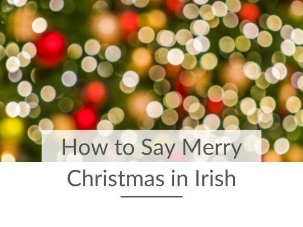 A picture of bokeh Christmas lights with text overlay saying How to Say Merry Christmas in Irish