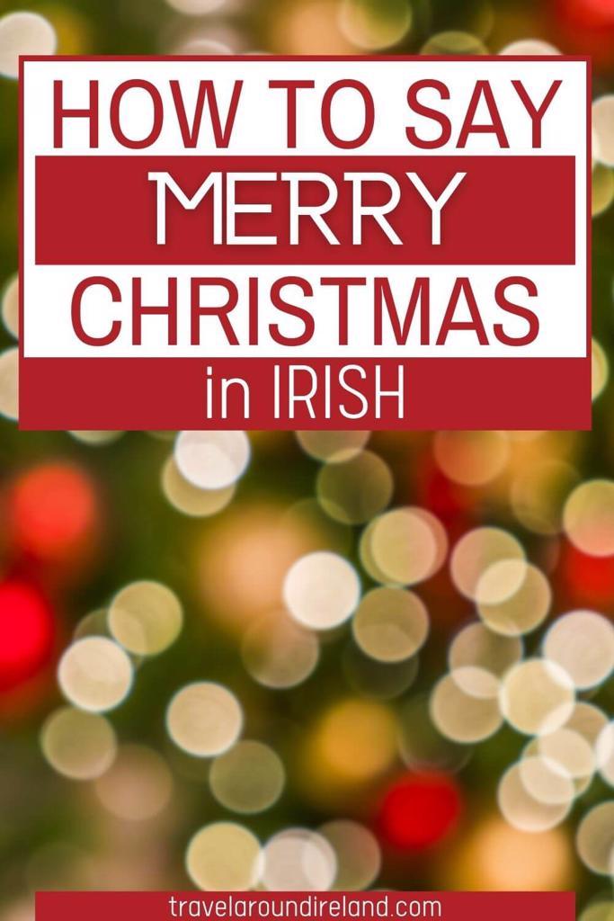 Christmas bokeh lights with text overlay saying How to Say Merry Christmas in Irish
