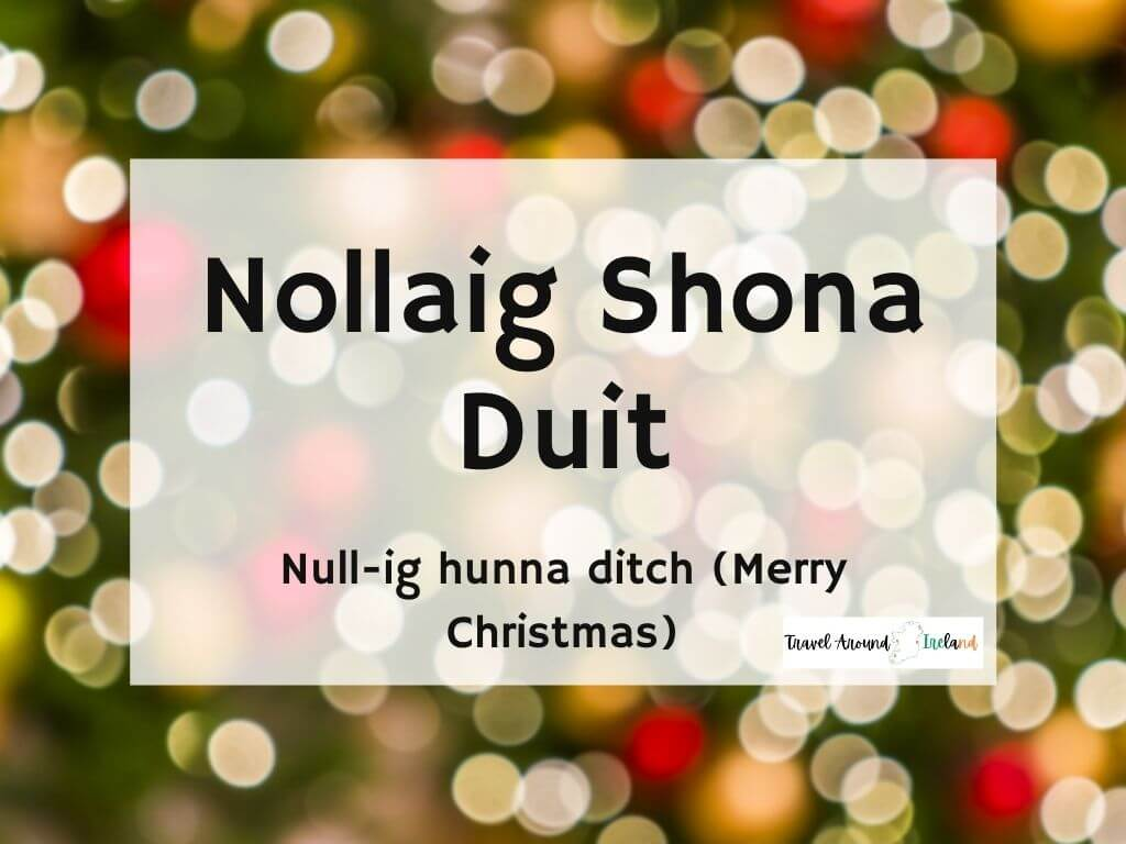 A picture with text over bokeh lights saying Nollaig Shona Duit meaning Merry Christmas in Irish